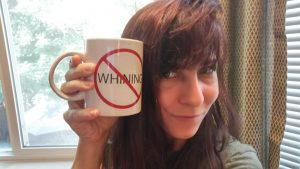 Christina holding a coffee mug- the source of her power
